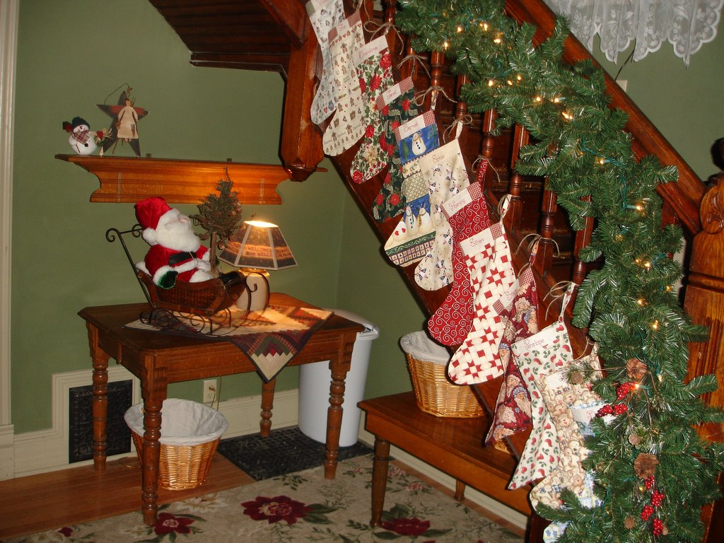 Day 23 the tradition of christmas stockings for Hang stockings staircase